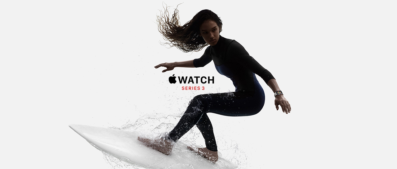 A woman surfing while wearing the Apple Watch Series 3
