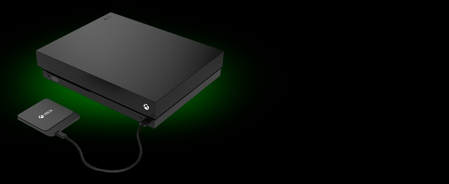 Seagate Game Drive for Xbox 500GB USB 3.0 SSD Plugged into a Black Xbox via USB Cable