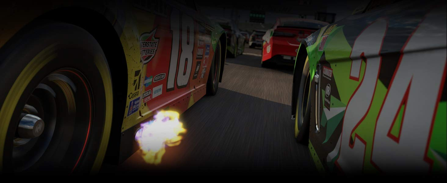 Closeup Shot of RaceCars Speeding on a Track with Fire Coming from the Exhaust of One Car
