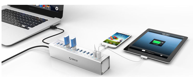 Orico Hub with a laptop, smartphone and tablet plugged in