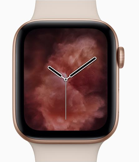 Apple Watch Series 4 facing forward showing the hands of a clock on a red cloudy smoke background