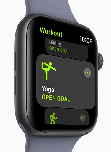 Apple Watch Series 4 facing slightly to the right with the workout app showing yoga and hiking windows