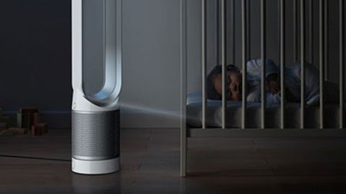 Dyson Pure Cool Link beside baby in a cot
