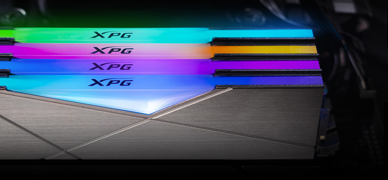 Four memory modules are illuminating in different colors.