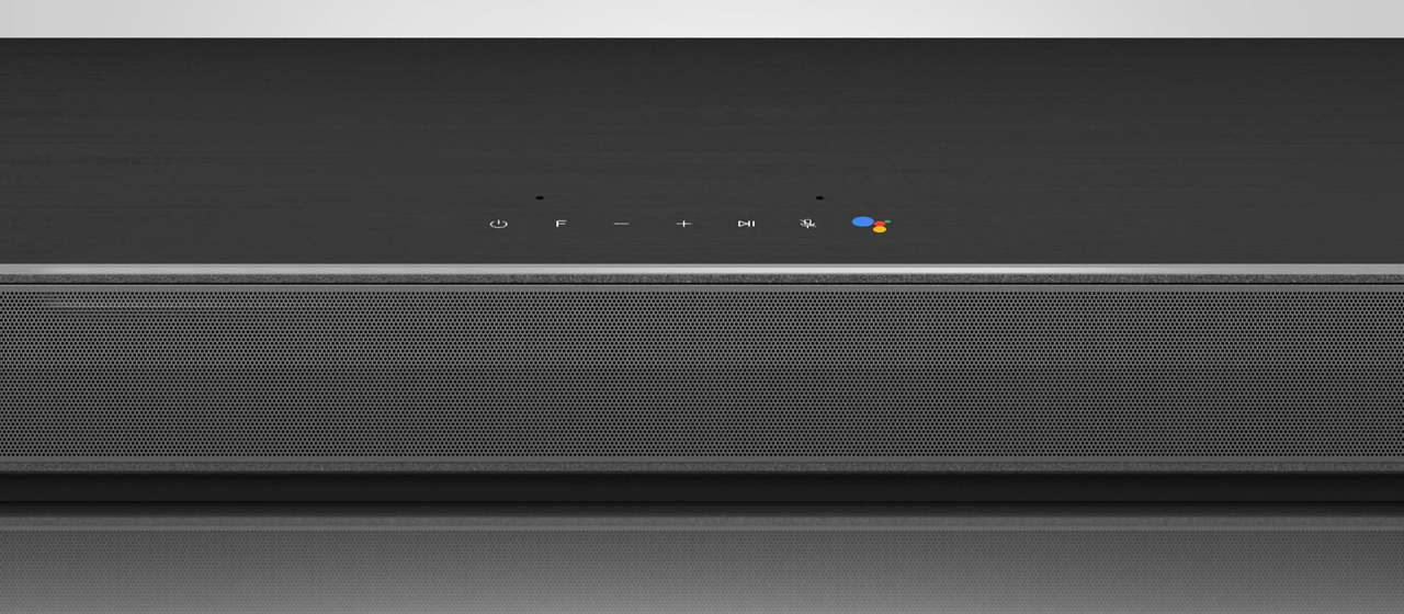 A google assistant icon is under a sound bar