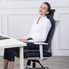 Demonstration of the cushion on an office chair . with a female reclining on the cushion