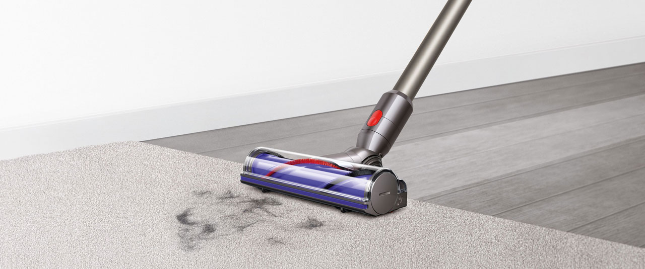 Closeup of the Dyson V8 cleaning on a carpet
