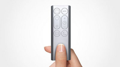 A tiny remote pinched by two fingers