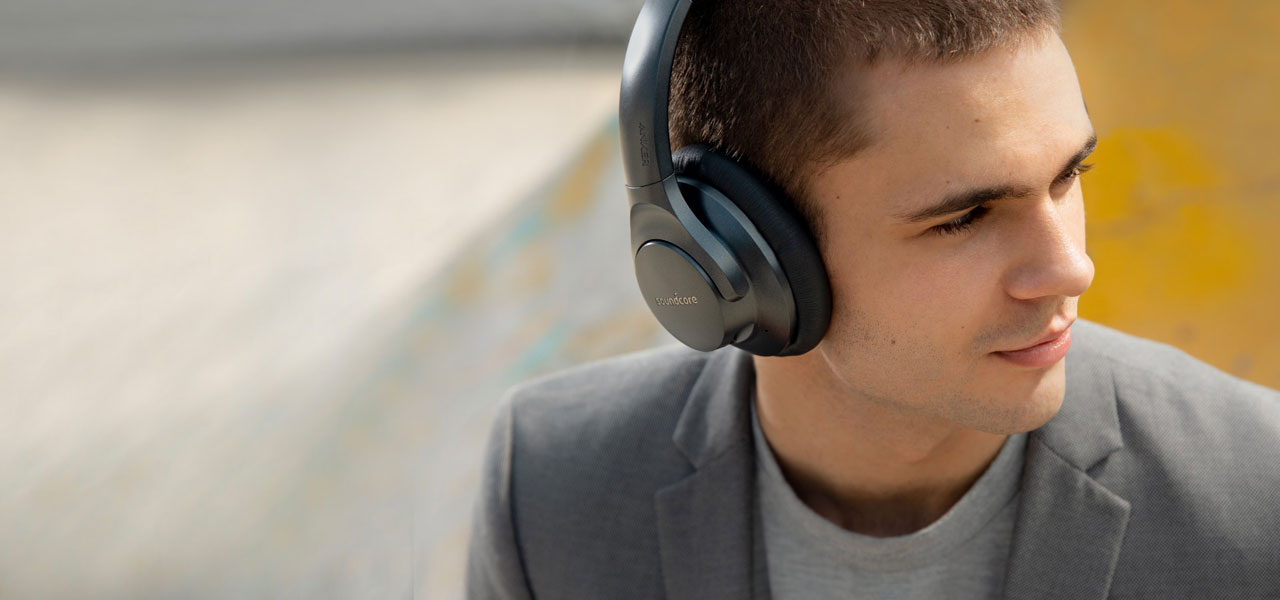 A young male wearing the Life 2 headset, facing to the right