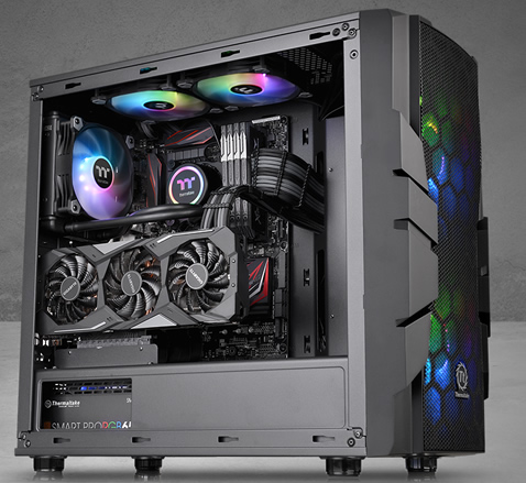 Thermaltake Commander C33 facing to the right fully loaded with components and RGB-lit fans
