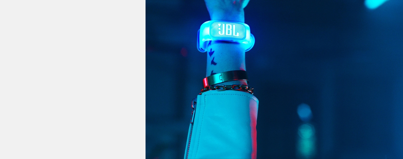JBL PartyBox 1000 Premium High Power Wireless Bluetooth Audio System is worn on the wrist