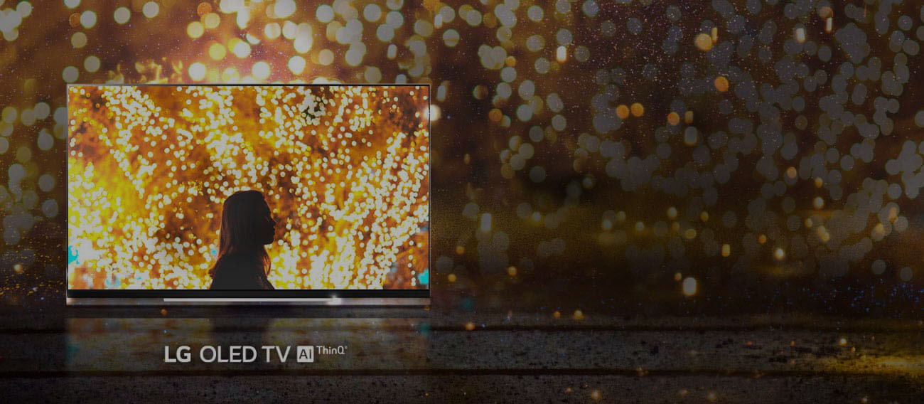LG E9 Glass Smart OLED TV showing a woman in a firework background