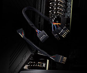 Closeup of two extension cables, with motherboard pin headers in the background