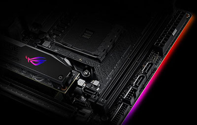 Top angle view of the motherboard, with ROG logo and onboard lighting glowing red color