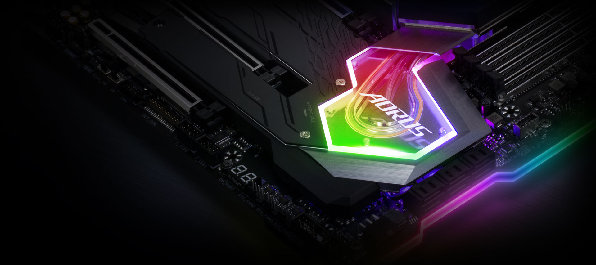 Closeup of the RGB-lit AORUS logo on the motherboard