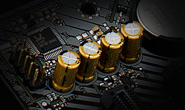 Closeup of the gold-plated audio caps on the ASRock b450 motherboard