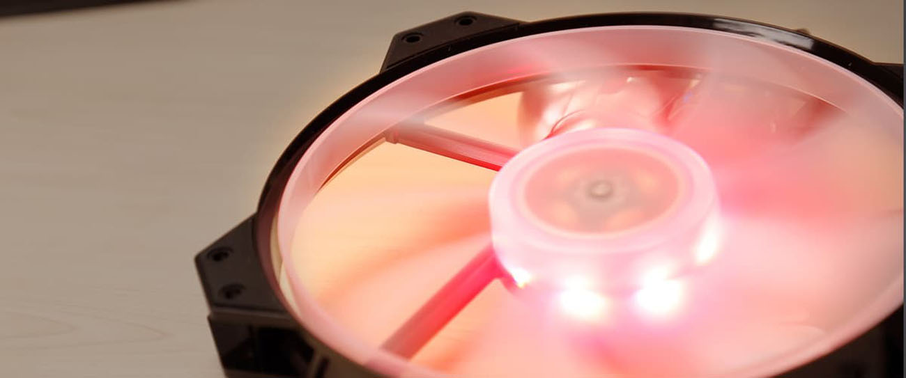 Cooler Master MF200R case fan looking up, spinning, with pink RGB lighting