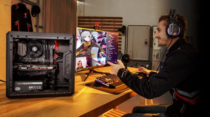 a man is happily playing games on a MSI gaming desktop