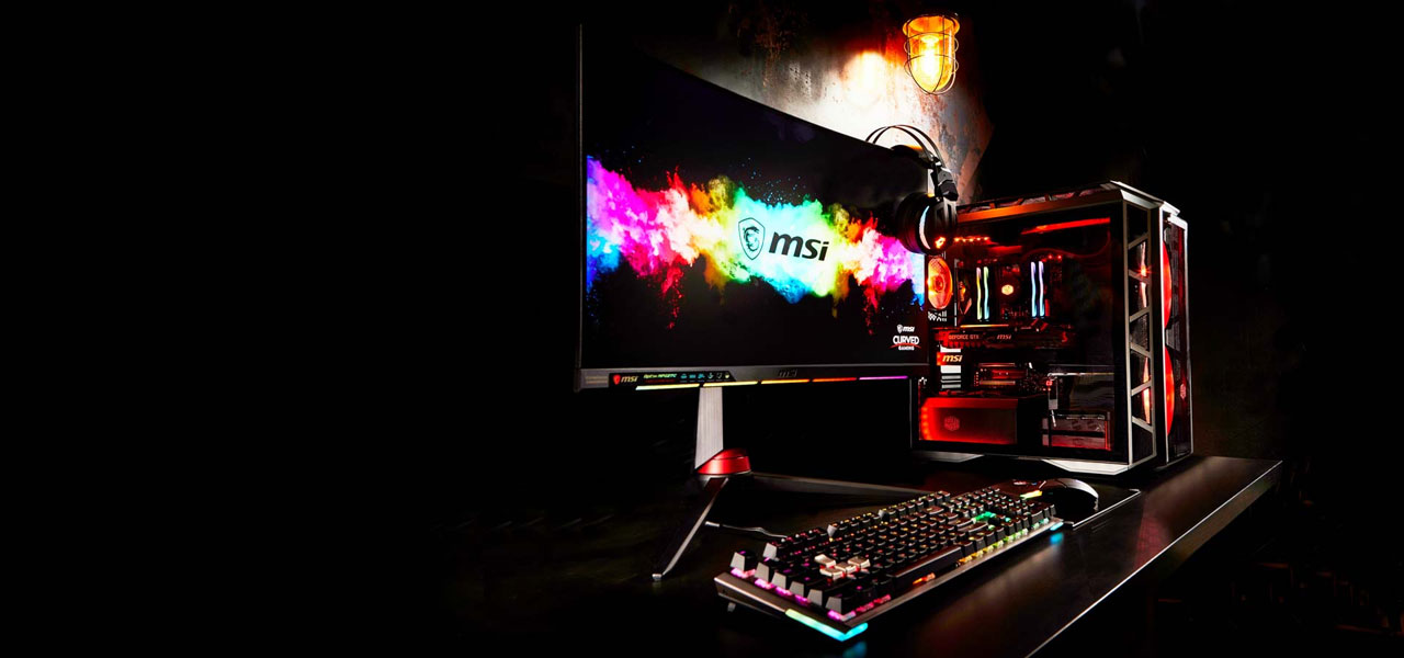 A RGB-lit gaming rig, with large logo displayed on the monitor