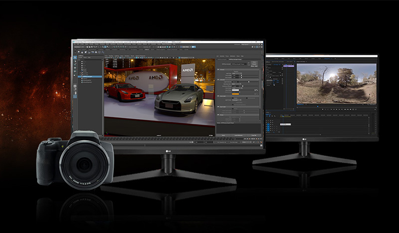 A DSLR camera next to two monitors that show photo and video editing software