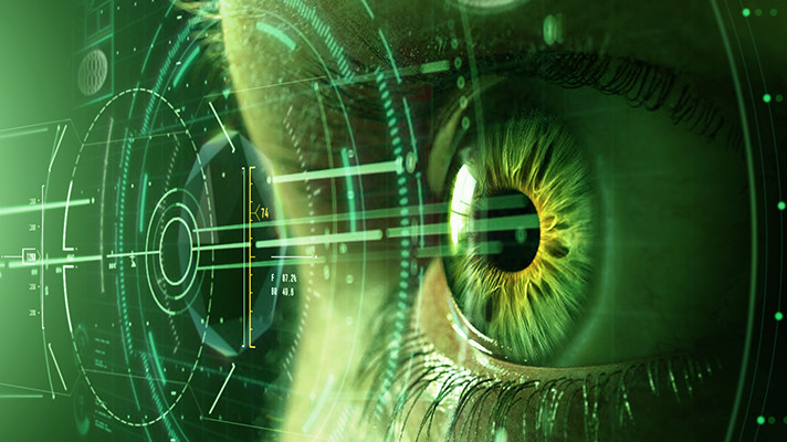 Green-Filtered Image of a Person's Eye Looking Through an AR Graphical Interface