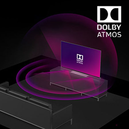 a TV with Dolby Atmos placed in front of a sofa