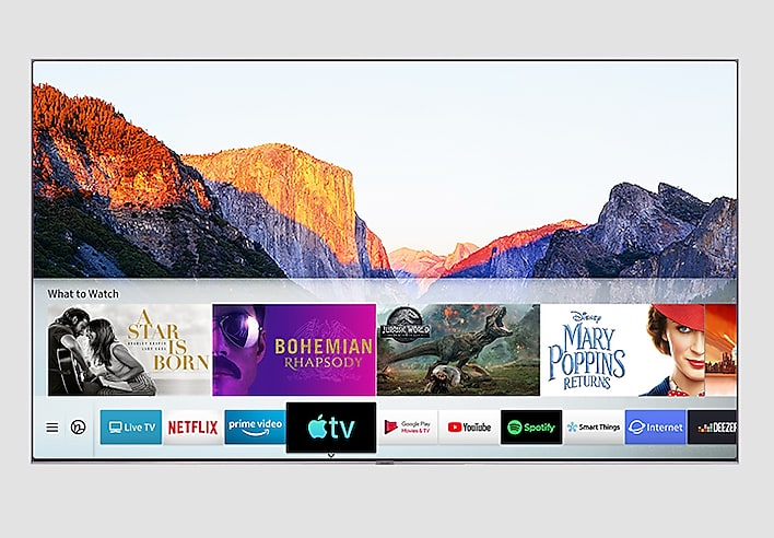 SAMSUNG Q80R Facing Forward with a National Park Mountain Range Background and What to Watch Movie Title Cards and logo + title cards streaming services