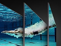 Underwater image of a swimmer diving into a pool