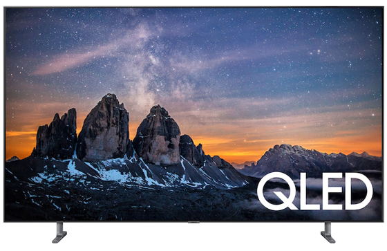 SAMSUNG Q80R Facing Forward with Mountain Rock Formations at sunset with stars in a dark blue sky