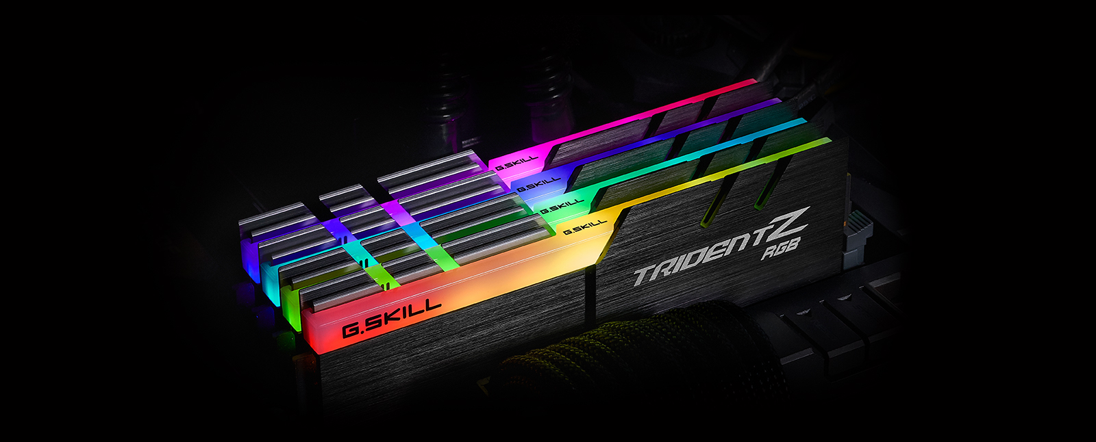 four tridentz rgb ddr4 memory installed on a motherboard, angled down to the right