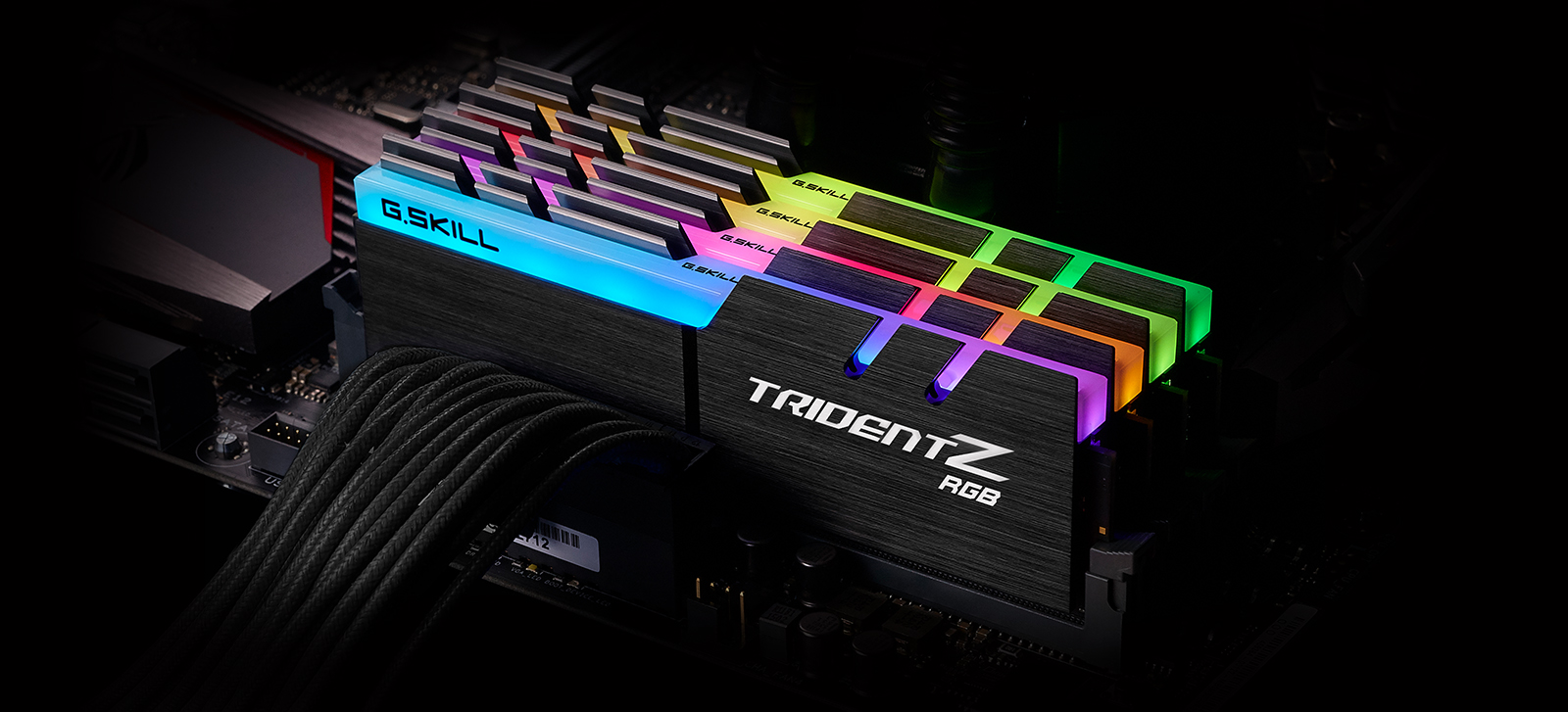 four tridentz rgb memory modules installed on a motherboard, angled to the left