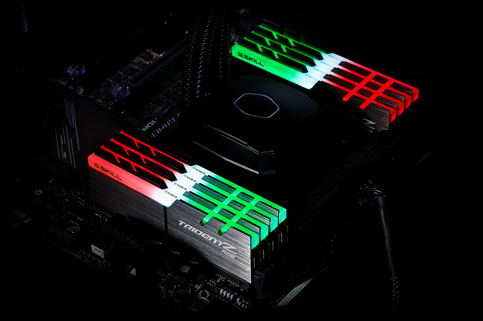 Two Sets of Four G.Skill TridentZ RGB Memory Modules Installed on a Motherboard
