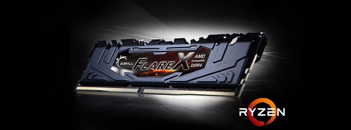 Flare X memory module in black heat spreader in standing position, angled slightly to the left, with a log of Ryzen next to it on the right