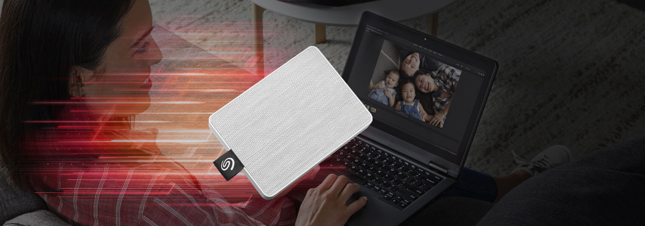 Illustration showing the One Touch portable SSD moving at blazing fast speed, with background of a female watching a family photo on a laptop