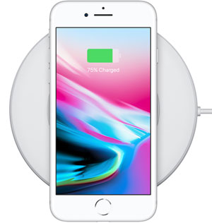 Top view of iPhone 8 placed on a wireless charging mat