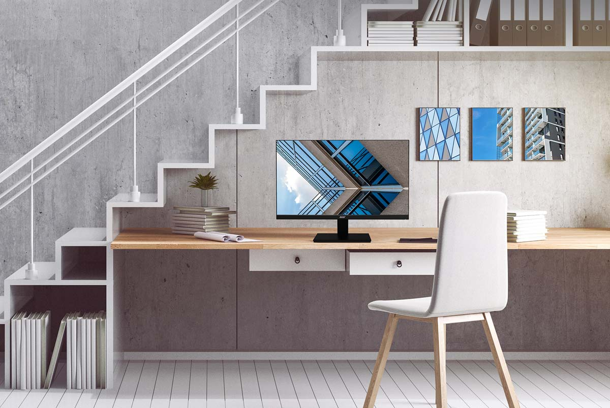 Acer V277U Monitor on a Desk Under a Modern Stairway at Home