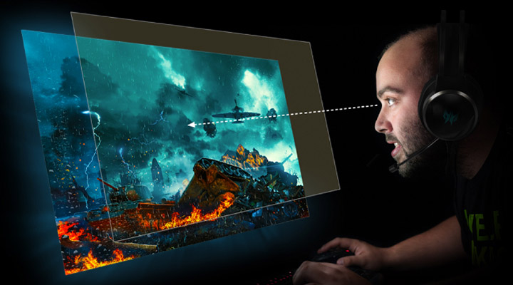 A man with a headset on looking close to his monitor screen that shoes war gameplay