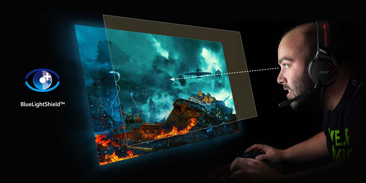 A man playing games in front of the monitor, with a layer of glass floating over the screen indicating blue light filtering