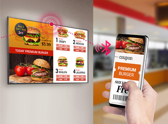 Mirrored burger restaurant ad from a smartphone being displayed onto a mounted LG commercial display. The phone shows a coupon that is being connected to the display via Bluetooth