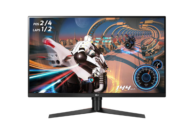 LG 32GK650G-B monitor facing forward showing a video game screenshot of a futuristic motorcycle racing through a sci-fi race track