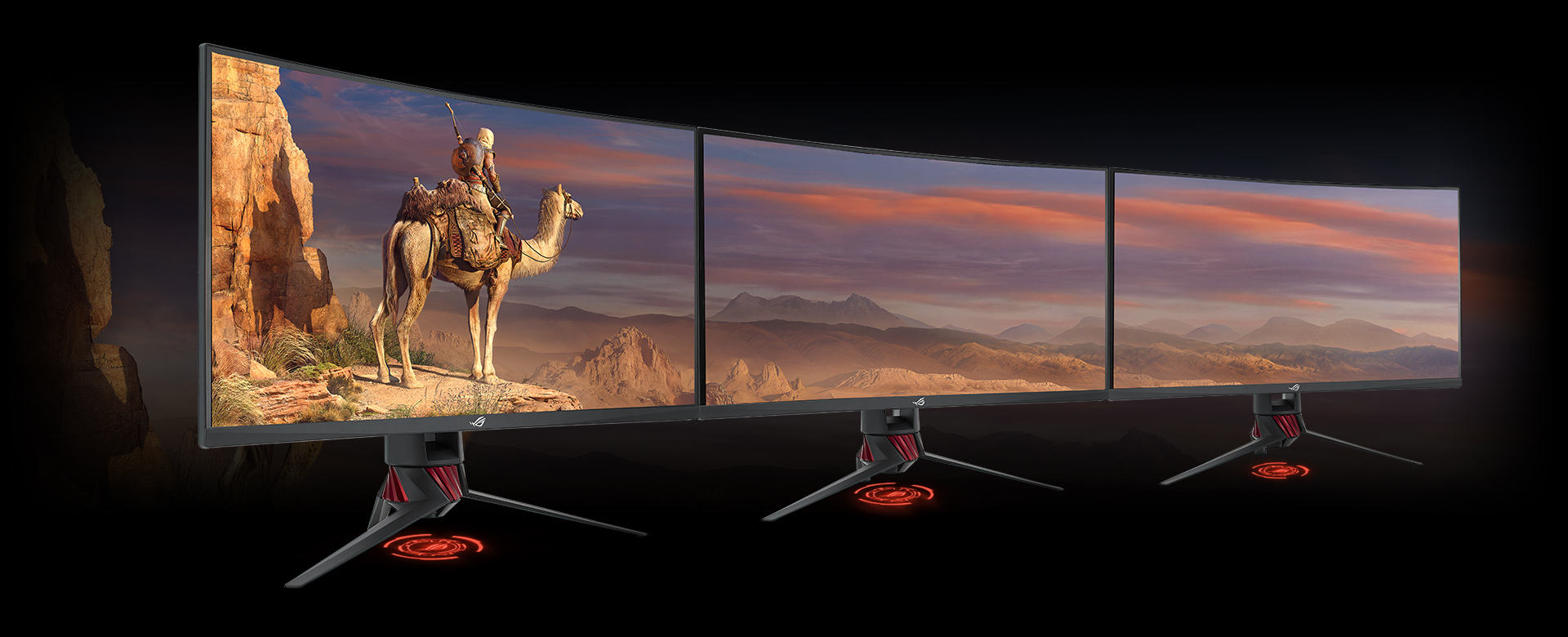 A Set of Three Monitors Side by Side, Forming a Connected Display with a desert scenery