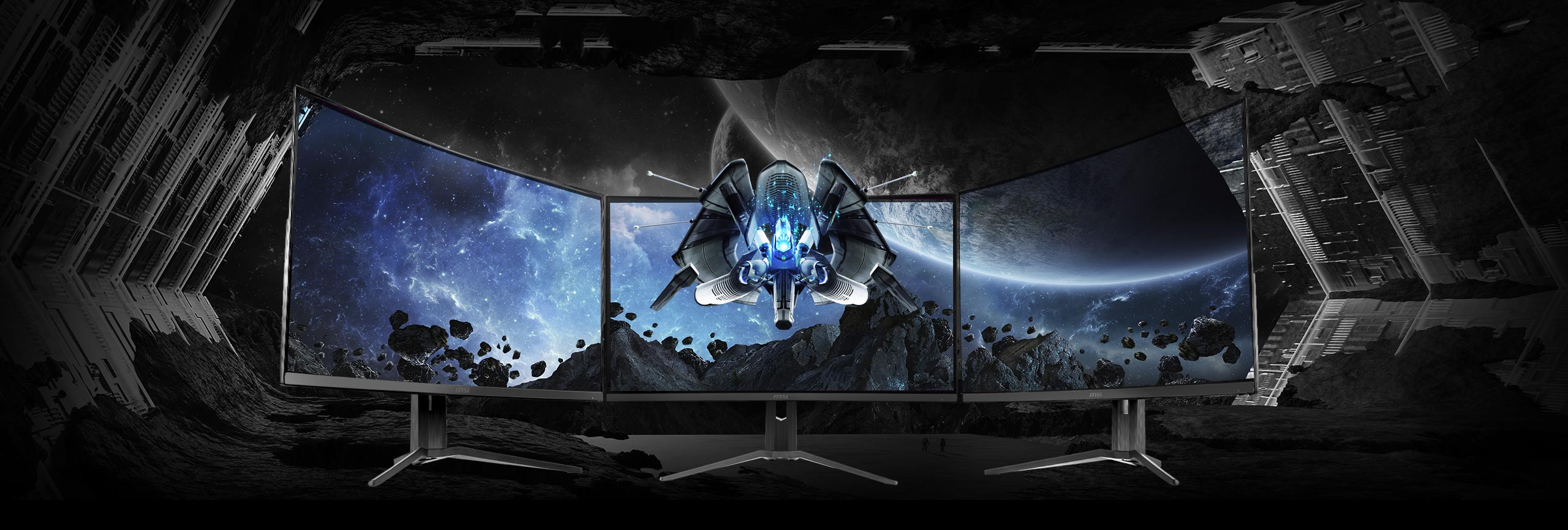 three monitors side-by-side with a space image as screen