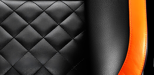 Closeup of the Couar Armor Titan gaming chair's leather back and sides