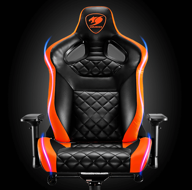 The Cougar Armor Titan Gaming Chair facing forward with orange accents on its sides