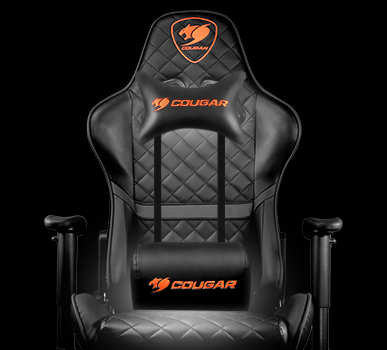 The Cougar Armor Titan Gaming Chair facing forward in all black with a head and lumbar pillow attached