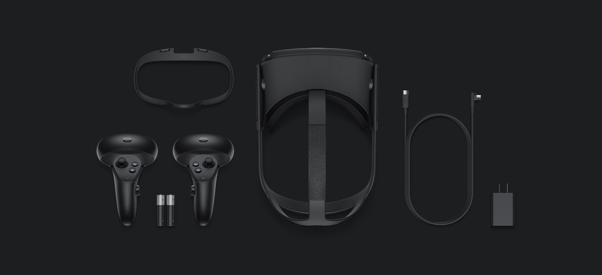 Oculus Rift S Gear lying down flat, the controllers, two AA batteries, the visor equipment, cable and outlet adapter