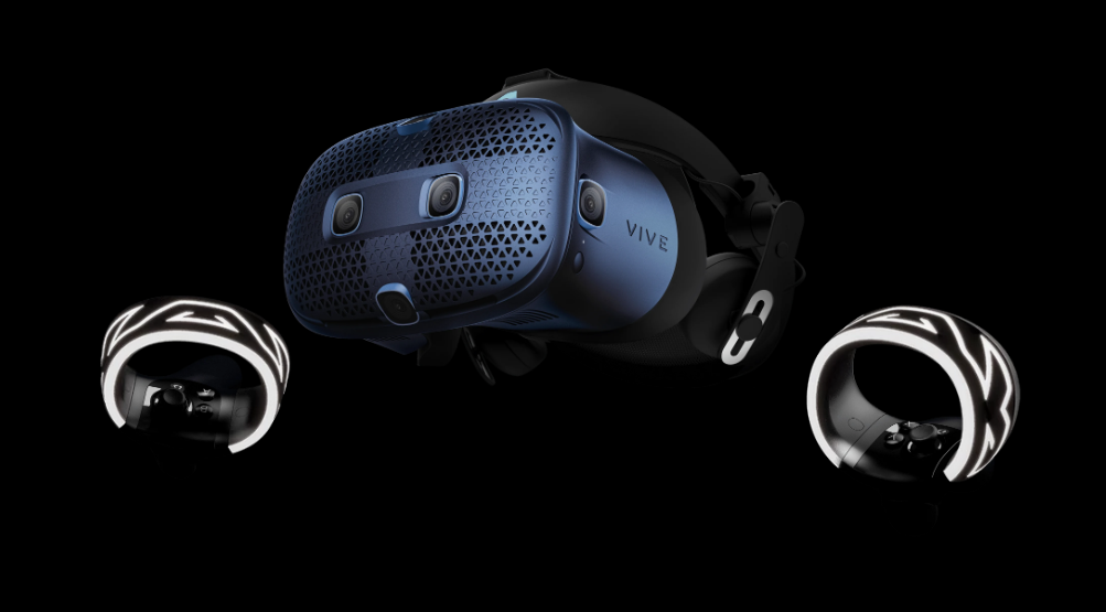 HTC VR Headset Angled to the Left, Next to the Two Hand Controllers