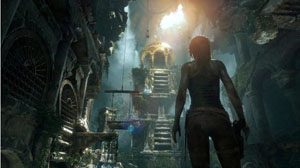 A screenshot of Lara looking up a tall dome with exposing stairs