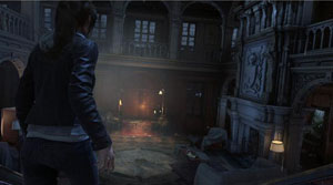 A screenshot of Lara entering a lobby illuminated by lights