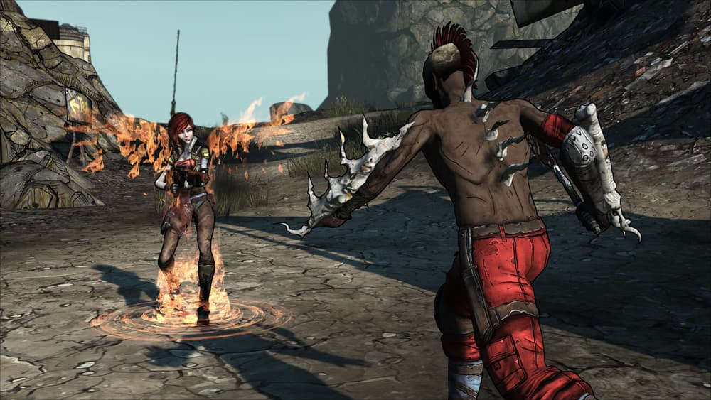 Borderlands Game of the Year Edition Screenshot Showing an Enemy Going Towards a Female Player Who Has Flame Wings Protruding from her back